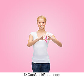 woman in blank t-shirt with pink cancer ribbon - healthcare,...