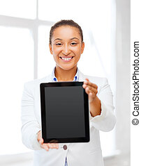 businesswoman with tablet pc in office