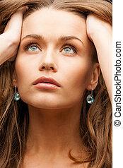 beautiful calm woman with beautiful earrings