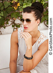 attractive brunette woman with sunglasses and red lips
