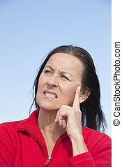 Thoughtful worried mature woman