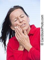 Woman in pain with toothache