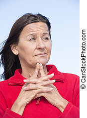 Worried mature woman wrinkled forehead
