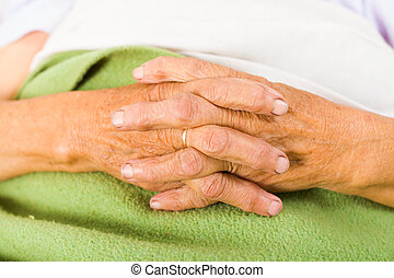 Elder People's Daily Prayers - Elder woman in bed saying her...