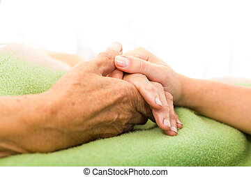Care for Elderly - Social services nurse holding elderly...
