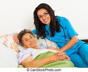 Nurse Caring for Elder Patients - Smiling nurse caring for...