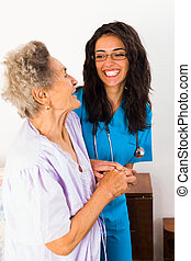 Caring Nurses - Nurses caring for elderly patients suffeing...