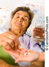 Supplements for Seniors - Supplements in nurses hands for...
