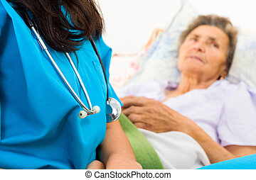 Kind Nurse with Elderly - Kind nurse easing elderly ladys...