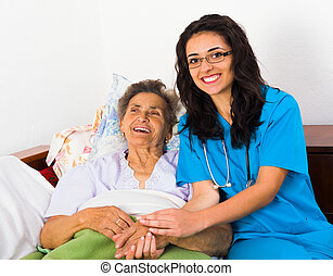 Fun with Patients - Caring nurse having fun with kind...