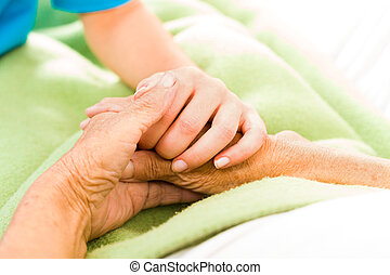Helping the Needy - Health care nurse caring for elderly...
