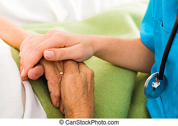 Nurses Helping Elderly - Social care provider holding senior...