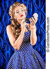 glamorous make-up - Portrait of a charming pin-up girl doing...