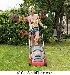 women with lawn mower