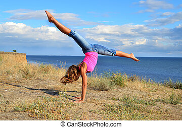 Dancer exercising near the sea