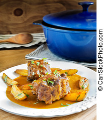 Bull tail stew Spanish style - Bull tail stew with fried...
