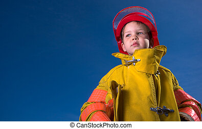 Never to young to dream - A little boy dressed up as a fire...