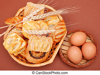 assorted bakery foodstuffs, wheat ears and egg