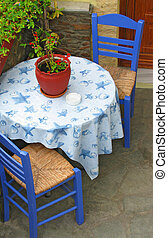 Outdoor table for two - Two traditional blue chairs and...