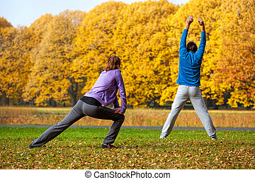 Exercising in colorful autumn park