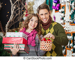 Couple Shopping Presents In Christmas Store