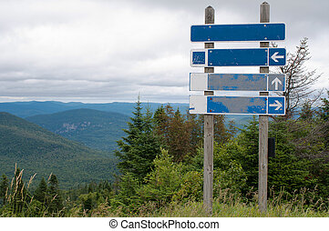Signpost on top of the mountain - Empty signpost on top of...