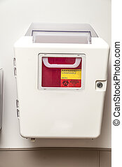 Sharps Container - Sharps container on the wal of a patient...