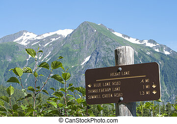 Heart Lake sign - Heart Lake trail marker with snow-capped...