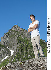 Confidence - Athletic Caucasian male hiker stands...