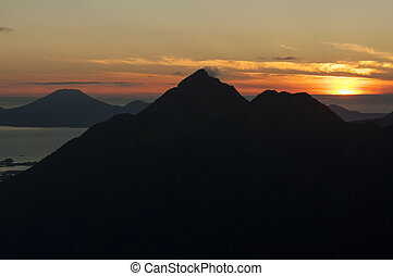 Mountain peak silhouette - Silhouetted peak of Mount...