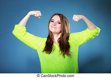 Girl shows her muscles strength and power - woman long hair...