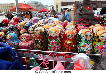 Colorful Russian nesting dolls at the market. - Colorful...