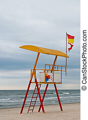 Empty Lifeguard Station on the Beach near a sea -...
