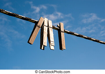 Clothespins on a line in a yard