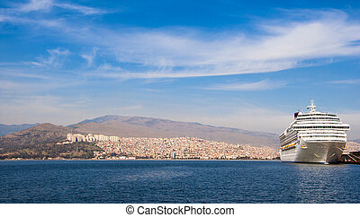 Izmir - Lanscape with a passenger ship docked in Izmir,...
