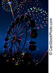 Ferris Wheel - Fireworks and a ferris wheel or big wheel at...