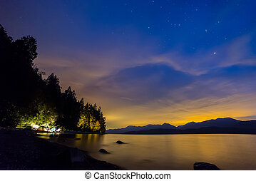 Orange and Blue Night Sky With Tents Camping - Camping in...