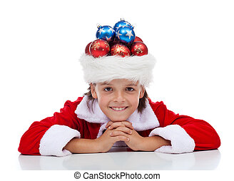 Christmas on your mind concept - child with santa hat full...