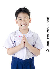 Asian child boy in student's uniform, acting sawaddee mean...