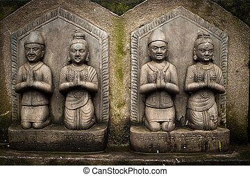 Sculpture of praying peoples. Nepal - Sculpture of praying...