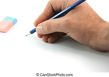 write eraser - writting with black pencil closeup and eraser...