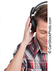 Man in headphones. Cropped image of handsome young man in...