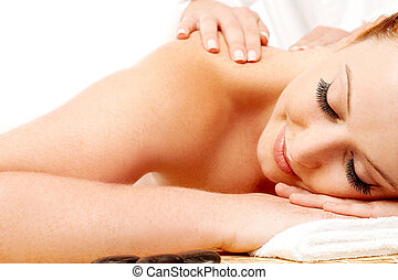 Attractive young lady getting a massage