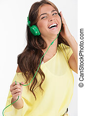 Beauty in headphones Cheerful young woman in headphones...