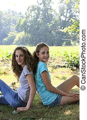 Two beautiful young girls in the park