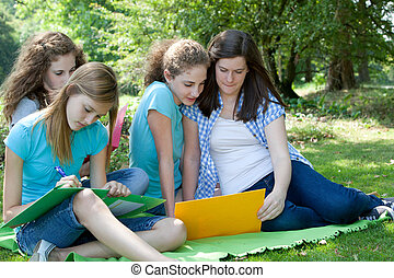Group of college students studying together - Group of...