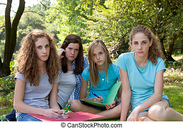 Group of sombre young teenagers - Group of sombre young...