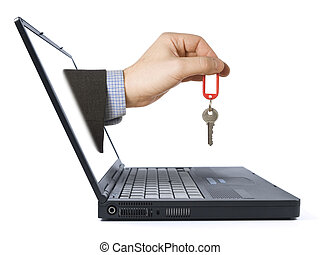 Online real estate - A mans hand with a key comes from the...