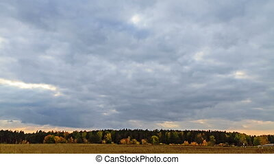 Rays of sun on a background autumn landscape. Time Lapse