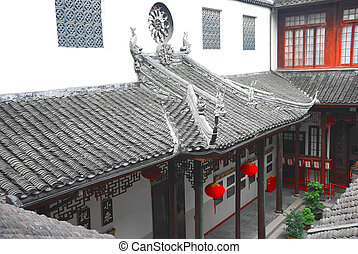 Ancient chinese house - Old tiled roof of ancient chinese...